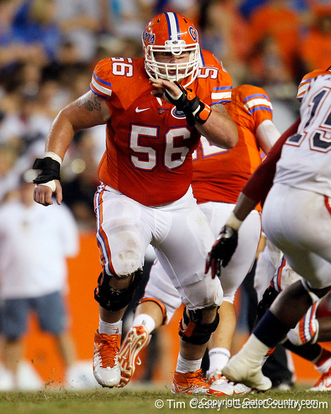 Florida redshirt senior center Dan Wenger blocks during the fourth quarter of the Gators' 41-3 win against the FAU Owls on Saturday, September 3, 2011 at Ben Hill Griffin Stadium in Gainesville, Fla. / Gator Country photo by Tim Casey
