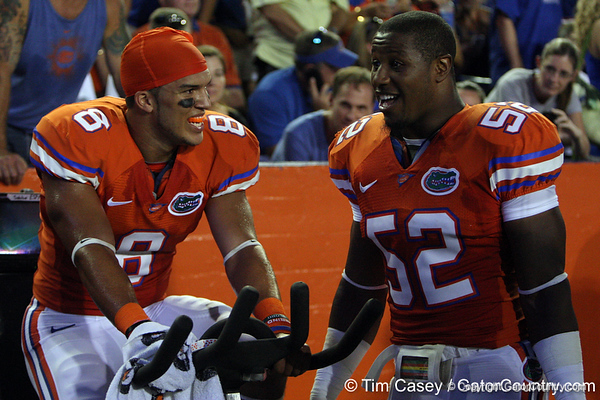 Florida sophomore running back Trey Burton talks with junior linebacker Jonathan Bostic during the second quarter of the Gators' 41-3 win against the FAU Owls on Saturday, September 3, 2011 at Ben Hill Griffin Stadium in Gainesville, Fla. / Gator Country photo by Tim Casey