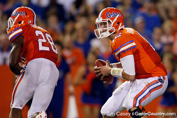 Florida redshirt senior quarterback John Brantley fakes a handoff during the third quarter of the Gators' 41-3 win against the FAU Owls on Saturday, September 3, 2011 at Ben Hill Griffin Stadium in Gainesville, Fla. / Gator Country photo by Tim Casey