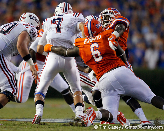 Florida redshirt senior defensive tackle Jaye Howard attempts to tackle FAU quarterback David Kooi during the second quarter of the Gators' 41-3 win against the FAU Owls on Saturday, September 3, 2011 at Ben Hill Griffin Stadium in Gainesville, Fla. / Gator Country photo by Tim Casey