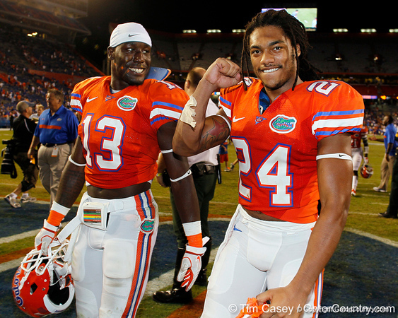 Florida junior linebacker Dee Finley and junior free safety Josh Evans walk off of the field after the Gators' 41-3 win against the FAU Owls on Saturday, September 3, 2011 at Ben Hill Griffin Stadium in Gainesville, Fla. / Gator Country photo by Tim Casey