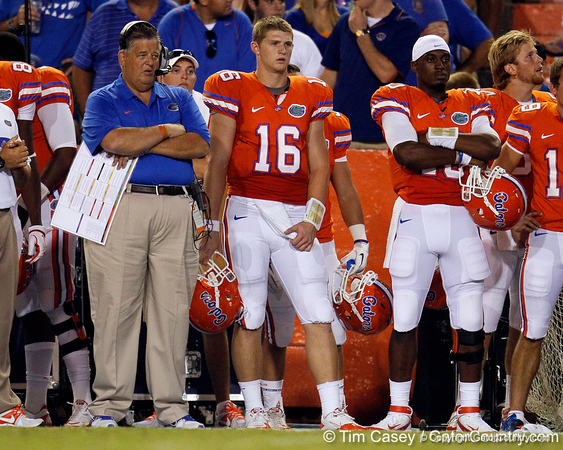 Florida offensive coordinator/quarterbacks coach Charlie Weis and freshman quarterback Jeff Driskel watch from the sideline during the third quarter of the Gators' 41-3 win against the FAU Owls on Saturday, September 3, 2011 at Ben Hill Griffin Stadium in Gainesville, Fla. / Gator Country photo by Tim Casey
