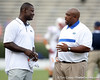 Kevin Carter talks with Florida strength coach Mark Campbell before the Gators' 41-3 win against the FAU Owls on Saturday, September 3, 2011 at Ben Hill Griffin Stadium in Gainesville, Fla. / Gator Country photo by Tim Casey