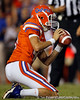 Florida redshirt sophomore kicker John Crofoot holds for an extra point during the second quarter of the Gators' 41-3 win against the FAU Owls on Saturday, September 3, 2011 at Ben Hill Griffin Stadium in Gainesville, Fla. / Gator Country photo by Tim Casey