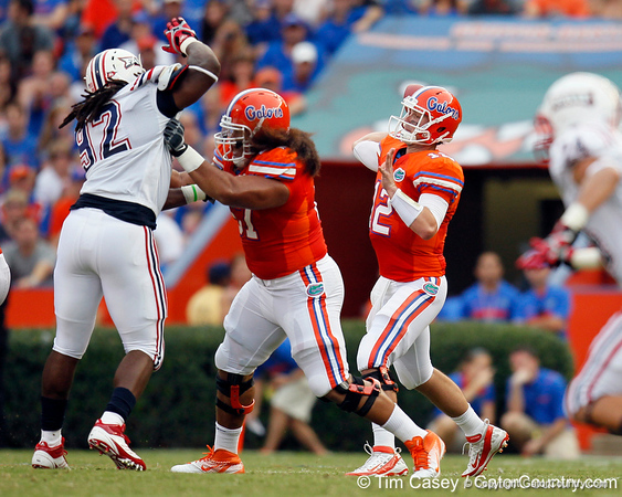 Florida redshirt sophomore guard Jon Halapio blocks as redshirt senior quarterback John Brantley passes during the first quarter of the Gators' 41-3 win against the FAU Owls on Saturday, September 3, 2011 at Ben Hill Griffin Stadium in Gainesville, Fla. / Gator Country photo by Tim Casey