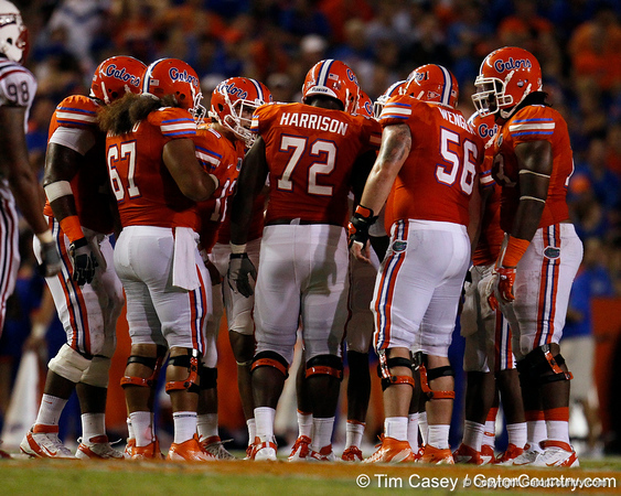 Florida players huddle during the third quarter of the Gators' 41-3 win against the FAU Owls on Saturday, September 3, 2011 at Ben Hill Griffin Stadium in Gainesville, Fla. / Gator Country photo by Tim Casey