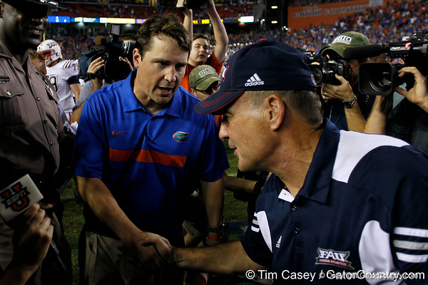 Florida head coach Will Muschamp talks across the field to shake hands after the Gators' 41-3 win against the FAU Owls on Saturday, September 3, 2011 at Ben Hill Griffin Stadium in Gainesville, Fla. / Gator Country photo by Tim Casey