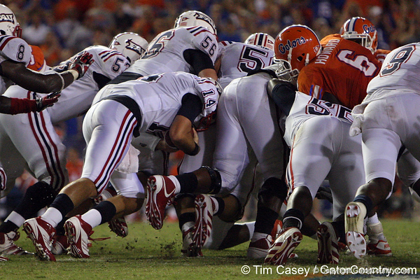 FAU quarterback Graham Wilbert gains two yards on a sneak during the third quarter of the Gators' 41-3 win against the FAU Owls on Saturday, September 3, 2011 at Ben Hill Griffin Stadium in Gainesville, Fla. / Gator Country photo by Tim Casey