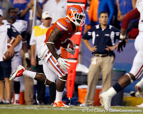Florida redshirt senior receiver Deonte Thompson gains 13 yards to the 29-yard line on a pass from John Brantley during the second quarter of the Gators' 41-3 win against the FAU Owls on Saturday, September 3, 2011 at Ben Hill Griffin Stadium in Gainesville, Fla. / Gator Country photo by Tim Casey