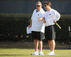Florida offensive coordinator Charlie Weis talks with head coach Will Muschamp during the Gators' practice on Wednesday, March 16, 2011 at the Sanders football practice fields. / photo courtesy of UF Communications