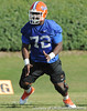 Florida redshirt sophomore guard Jonotthan Harrison blocks during the Gators' practice on Wednesday, March 16, 2011 at the Sanders football practice fields. / photo courtesy of UF Communications
