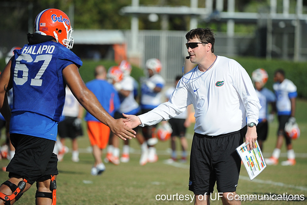 Florida redshirt sophomore guard Jon Halapio slaps hands with head coach Will Muschamp works out during the Gators' practice on Wednesday, March 16, 2011 at the Sanders football practice fields. / photo courtesy of UF Communications