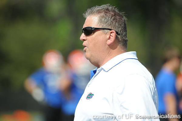 Florida offensive coordinator Charlie Weis oversees a drill during the Gators' practice on Wednesday, March 16, 2011 at the Sanders football practice fields. / photo courtesy of UF Communications