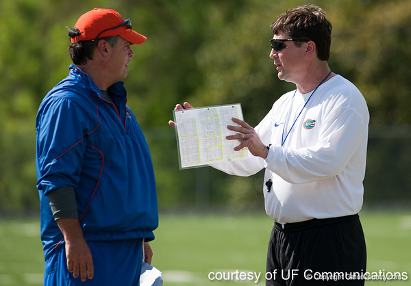 Florida offensive line coach/ running game Coordinator Frank Verducci talks with head coach Will Muschamp oversees a drill during the Gators' practice on Wednesday, March 16, 2011 at the Sanders football practice fields. / photo courtesy of UF Communications