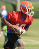 Florida redshirt freshman quarterback Tyler Murphy hands off during the Gators' practice on Wednesday, March 16, 2011 at the Sanders football practice fields. / photo courtesy of UF Communications