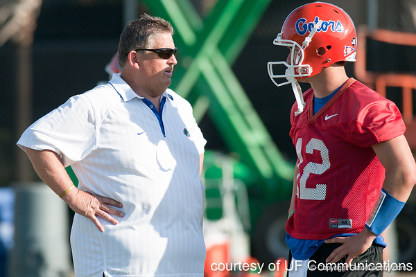 Florida offensive coordinator Charlie Weis talks with redshirt senior quarterback John Brantley during the Gators' practice on Wednesday, March 16, 2011 at the Sanders football practice fields. / photo courtesy of UF Communications