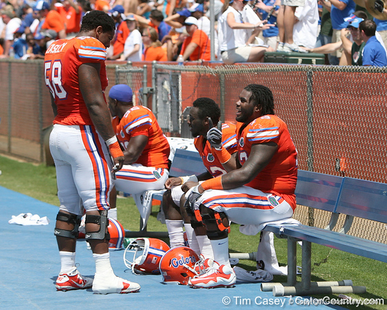 Florida sophomore defensive tackle Dominique Easley talks with sophomore defensive tackle Sharrif Floyd during the Gators' spring football game on Saturday, April 9, 2011 at Ben Hill Griffin Stadium in Gainesville, Fla. / Gator Country photo by Tim Casey