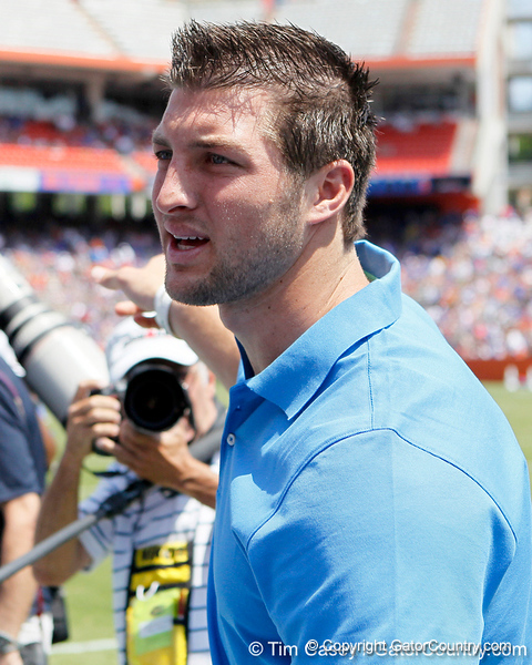 Tim Tebow talks on the sideline during the Gators' spring football game on Saturday, April 9, 2011 at Ben Hill Griffin Stadium in Gainesville, Fla. / Gator Country photo by Tim Casey