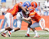 Florida sophomore linebacker Darrin Kitchens and senior cornerback Brian Biada tackle redshirt junior tight end Josh Postell during the Gators' spring football game on Saturday, April 9, 2011 at Ben Hill Griffin Stadium in Gainesville, Fla. / Gator Country photo by Tim Casey