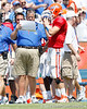 Florida offensive coordinator/quarterbacks coach Charlie Weis talks with redshirt senior quarterback John Brantley during the Gators' spring football game on Saturday, April 9, 2011 at Ben Hill Griffin Stadium in Gainesville, Fla. / Gator Country photo by Tim Casey