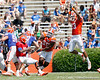 Florida redshirt freshman linebacker Chris Martin leaps as redshirt freshman quarterback Tyler Murphy looks to pass during the Gators' spring football game on Saturday, April 9, 2011 at Ben Hill Griffin Stadium in Gainesville, Fla. / Gator Country photo by Tim Casey