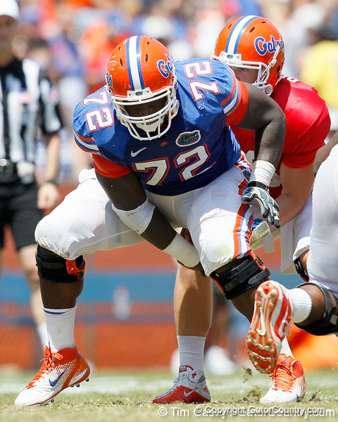 Florida redshirt sophomore guard Jonotthan Harrison snaps the ball during the Gators' spring football game on Saturday, April 9, 2011 at Ben Hill Griffin Stadium in Gainesville, Fla. / Gator Country photo by Tim Casey