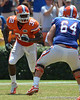 UF linebacker Gerald Christian comes off the edge while tackle Kyle Koehne moves to block him during the 2011 Orange and Blue Debut at Ben Hill Griffin Stadium on Saturday, April 9, 2011. / Gator Country photo by Harrison Diamond
