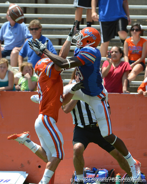 UF wide receiver Stephen Alli tries to catch a deep ball from quarterback Christian Provancha while cornerback Brian Biada breaks it up during the 2011 Orange and Blue Debut at Ben Hill Griffin Stadium on Saturday, April 9, 2011. / Gator Country photo by Harrison Diamond