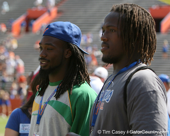 Seffner (Armwood HS) running back Matt Jones and Palm Beach Gardens (Palm Beach Gardens HS) offensive tackle Avery Young watch warmups before the Gators' spring football game on Saturday, April 9, 2011 at Ben Hill Griffin Stadium in Gainesville, Fla. / Gator Country photo by Tim Casey