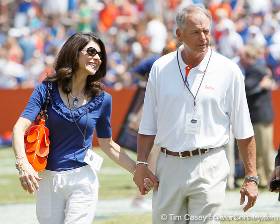 Pam and Bob Tebow walk across the field during the Gators' spring football game on Saturday, April 9, 2011 at Ben Hill Griffin Stadium in Gainesville, Fla. / Gator Country photo by Tim Casey