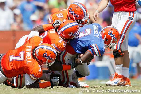 Florida redshirt senior running back/receiver Chris Rainey gets tackled during the Gators' spring football game on Saturday, April 9, 2011 at Ben Hill Griffin Stadium in Gainesville, Fla. / Gator Country photo by Tim Casey