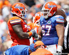Florida sophomore defensive tackle Sharrif Floyd shakes hands with redshirt sophomore tackle/guard Jon Halapio during the Gators' spring football game on Saturday, April 9, 2011 at Ben Hill Griffin Stadium in Gainesville, Fla. / Gator Country photo by Tim Casey