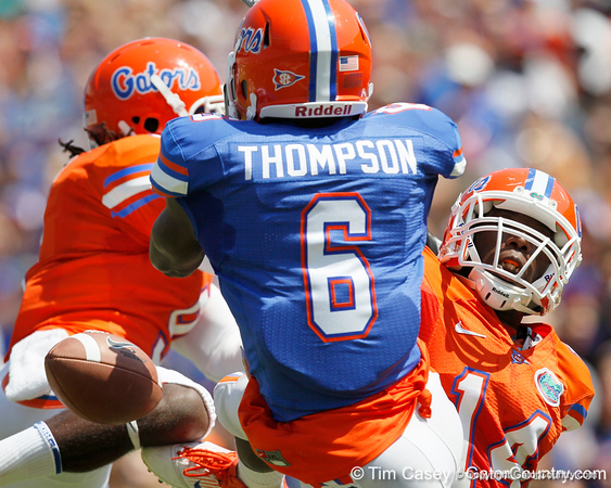 Florida sophomore safety Joshua Shaw and sophomore cornerback Jaylen Watkins break up a pass intended for redshirt senior receiver Deonte Thompson during the Gators' spring football game on Saturday, April 9, 2011 at Ben Hill Griffin Stadium in Gainesville, Fla. / Gator Country photo by Tim Casey