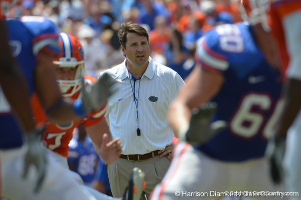 UF head coach Will Muschamp watches as kicker Brad Phillips kicks the final extra point of the the 2011 Orange and Blue Debut at Ben Hill Griffin Stadium on Saturday, April 9, 2011. / Gator Country photo by Harrison Diamond