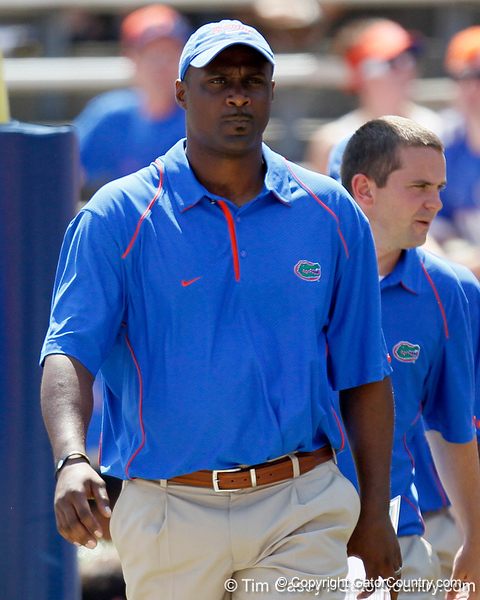 Florida tight ends coach Derek Lewis walks across the field before the Gators' spring football game on Saturday, April 9, 2011 at Ben Hill Griffin Stadium in Gainesville, Fla. / Gator Country photo by Tim Casey