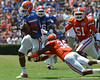 UF wide receiver Stephen Alli runs after a catch while cornerback Moses Jenkins tries to bring him down during the 2011 Orange and Blue Debut at Ben Hill Griffin Stadium on Saturday, April 9, 2011. / Gator Country photo by Harrison Diamond