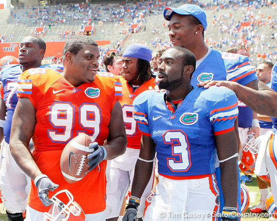 Florida redshirt junior nose tackle Omar Hunter celebrates with redshirt senior running back/receiver Chris Rainey and redshirt freshman tight end Michael McFarland after the Gators' spring football game on Saturday, April 9, 2011 at Ben Hill Griffin Stadium in Gainesville, Fla. / Gator Country photo by Tim Casey