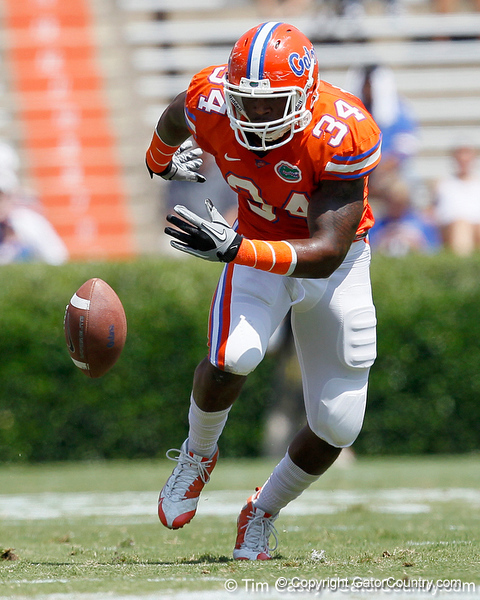 Florida redshirt junior defensive end Lerentee McCray chases a batted ball during the Gators' spring football game on Saturday, April 9, 2011 at Ben Hill Griffin Stadium in Gainesville, Fla. / Gator Country photo by Tim Casey