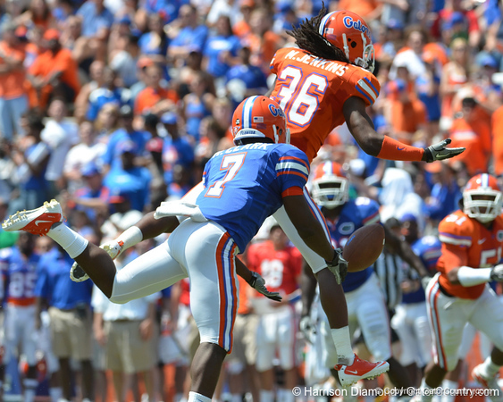 UF cornerback Moses Jenkins breaks up a pass intended for Robert Clark during the 2011 Orange and Blue Debut at Ben Hill Griffin Stadium on Saturday, April 9, 2011. / Gator Country photo by Harrison Diamond