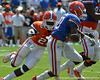UF linebacker Gideon Ajagbe tackles Malcolm Jones during the 2011 Orange and Blue Debut at Ben Hill Griffin Stadium on Saturday, April 9, 2011. / Gator Country photo by Harrison Diamond