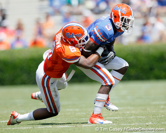 Florida redshirt senior running back/receiver Chris Rainey gets tackled by redshirt junior cornerback Jeremy Brown during the Gators' spring football game on Saturday, April 9, 2011 at Ben Hill Griffin Stadium in Gainesville, Fla. / Gator Country photo by Tim Casey