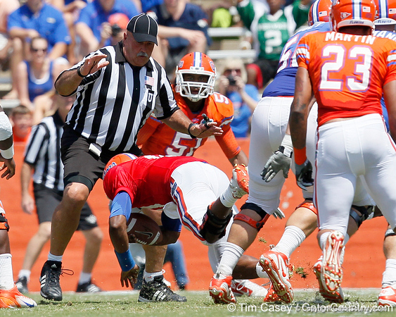 Florida redshirt freshman quarterback Tyler Murphy falls forward during the Gators' spring football game on Saturday, April 9, 2011 at Ben Hill Griffin Stadium in Gainesville, Fla. / Gator Country photo by Tim Casey