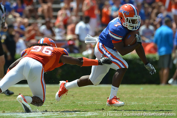 UF wide receiver Robert Clark evades a tackle attempt by cornerback Moses Jenkins during the 2011 Orange and Blue Debut at Ben Hill Griffin Stadium on Saturday, April 9, 2011. / Gator Country photo by Harrison Diamond