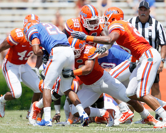 Florida freshman defensive end/linebacker Clay Burton tackles sophomore running back Deandre Goins during the Gators' spring football game on Saturday, April 9, 2011 at Ben Hill Griffin Stadium in Gainesville, Fla. / Gator Country photo by Tim Casey