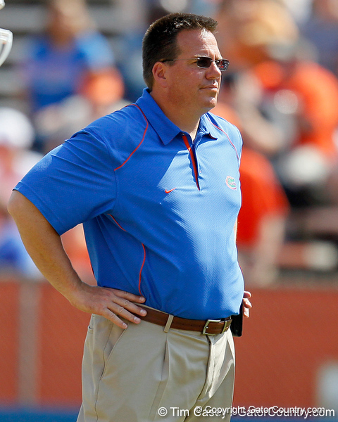 Florida running backs coach Brian White oversees warmups before the Gators' spring football game on Saturday, April 9, 2011 at Ben Hill Griffin Stadium in Gainesville, Fla. / Gator Country photo by Tim Casey
