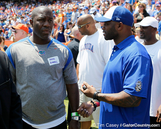 Former Florida players Mike Harris and Fred Taylor talk during the Gators' spring football game on Saturday, April 9, 2011 at Ben Hill Griffin Stadium in Gainesville, Fla. / Gator Country photo by Tim Casey