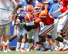 Florida sophomore cornerback Cody Riggs and redshirt freshman linebacker Michael Taylor tackle redshirt senior receiver Deonte Thompson during the Gators' spring football game on Saturday, April 9, 2011 at Ben Hill Griffin Stadium in Gainesville, Fla. / Gator Country photo by Tim Casey