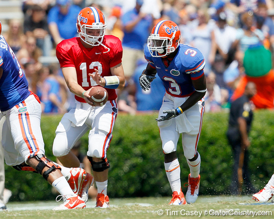 Florida redshirt senior quarterback John Brantley hands off to redshirt senior running back/receiver Chris Rainey during the Gators' spring football game on Saturday, April 9, 2011 at Ben Hill Griffin Stadium in Gainesville, Fla. / Gator Country photo by Tim Casey