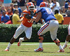 UF linebacker Gerald Christian comes off the edge while tackle Kyle Koehne engages him during the 2011 Orange and Blue Debut at Ben Hill Griffin Stadium on Saturday, April 9, 2011. / Gator Country photo by Harrison Diamond