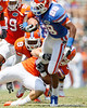 Florida sophomore safety Joshua Shaw eyes sophomore running back Deandre Goins as he runs for a 19-yard gain to the 16-yard line during the Gators' spring football game on Saturday, April 9, 2011 at Ben Hill Griffin Stadium in Gainesville, Fla. / Gator Country photo by Tim Casey